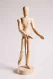 Wooden mannequin for painting on a white Royalty Free Stock Images