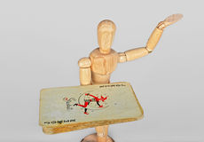 Wooden mannequin with playing cards. Old vintage poker cards in the hand of the wooden mannequin royalty free stock photos
