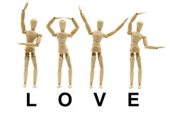Wooden Mannequin Posed Word. Collection of Wooden Mannequin Posed Word LOVE Concept stock photo