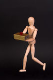 A wooden mannequin with present Royalty Free Stock Photography