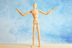 Wooden mannequin with raised hands Royalty Free Stock Photos