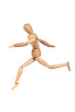 A wooden mannequin running Royalty Free Stock Photos