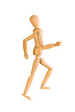 Wooden mannequin running upstairs royalty free stock photography