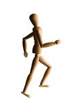 Wooden mannequin running upstairs Royalty Free Stock Photo