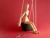 Wooden Mannequin and scissors Royalty Free Stock Photography