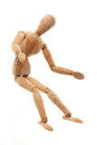 Wooden mannequin sitting Stock Image