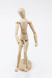 A wooden mannequin standing. A wooden mannequin standing, on it`s stand, on a white surface stock photography