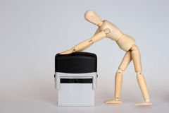 Wooden mannequin stumping. Wooden mannequin doll with the stamp stock photography