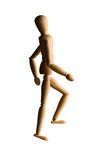 Wooden mannequin walking upstairs Royalty Free Stock Photos
