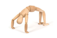 A wooden mannequin work out Royalty Free Stock Image