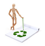 Wooden mannequin writing - Recycle stock photos