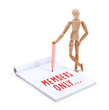 Wooden mannequin writing in scrapbook - Members only Royalty Free Stock Photography