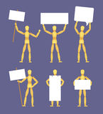 Wooden mannequins with the blank white signs Stock Photography