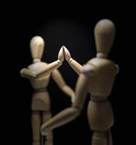 Wooden Mannequins-hi5-close-focusBlur-overshoulder 01 Royalty Free Stock Photo
