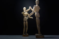 Wooden Mannequins-hi5 lower back-vin Royalty Free Stock Photo
