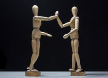 Wooden Mannequins-hi5 lower side Royalty Free Stock Photo