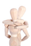 Wooden mannequins hugging Royalty Free Stock Photo