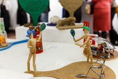 Wooden mannequins with tennis racket Royalty Free Stock Photography