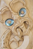 Wooden Maori carving with paua shells Royalty Free Stock Image