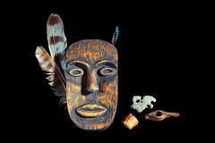 Wooden mask on a black background Royalty Free Stock Photos