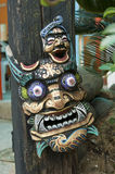 Wooden mask. At the entrance of a home, Hong Kong Stock Images