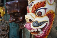 Wooden mask for sale at a street market Kathmandu, Nepal stock image