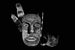 Wooden mask of the tribal chief. On a black background Royalty Free Stock Images