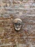 Wooden mask on wall stock images