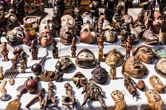 Wooden masks and figures of African culture at the flea market i Stock Photo