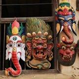 Colorful timber masks representing Hindu gods. Wooden masks representing hindu gods. Scene in Kathmandu, Nepal stock photos