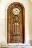 Wooden Mass Clock Stock Photo