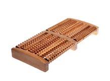 Wooden massager for feet Stock Photos