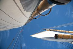 Full Sails on Wooden Masts of Saliboat with Blue Sky royalty free stock images