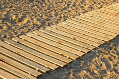 Wooden mat on a sandy beach Royalty Free Stock Photo