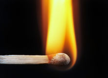 Wooden Match. Ignited Wooden Match Stick on Black Background Stock Photo