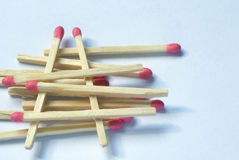 Wooden match sticks stacked one upon the other Stock Photos