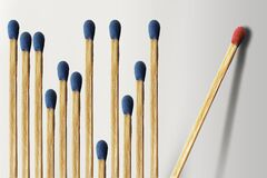 Free Wooden Matches Are Lined Up With A Dozen Blue Matches On The Left And One Red Match Isolated And Alone Stock Photo - 212931600