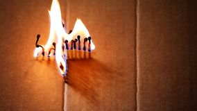 Wooden matches fire flame paper box cross HD footage. Studio stock footage