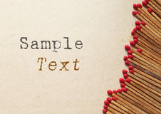 Wooden matches on old paper with copy space. And sample text Royalty Free Stock Photos