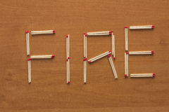 Wooden matches. With word fire Stock Photos