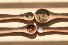 Measuring spoons with spices royalty free stock images