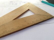 Wooden measuring stick and pencil Stock Image
