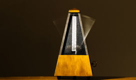 Wooden Mechanical Metronome With Motion Blur Arm Royalty Free Stock Images
