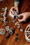Wooden mechanical toy. Miniature wooden mechanical toy Ferris wheel is on the table royalty free stock photography