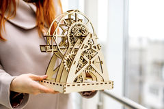 Wooden mechanical toy. Miniature wooden mechanical toy Ferris wheel is on the table royalty free stock image