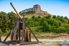 Wooden medieval catapult Stock Images