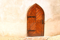 Wooden medieval door at a historical tower Stock Image