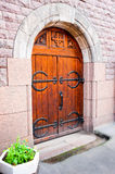 Wooden medieval gate in stone wall of castle Royalty Free Stock Photos