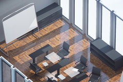 Wooden meeting room top. Top view of wooden meeting room with empty whiteboard stand, workplace and sunlight Mock up, 3D Rendering. Filtered image Royalty Free Stock Photography
