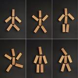 Wooden men Stock Image